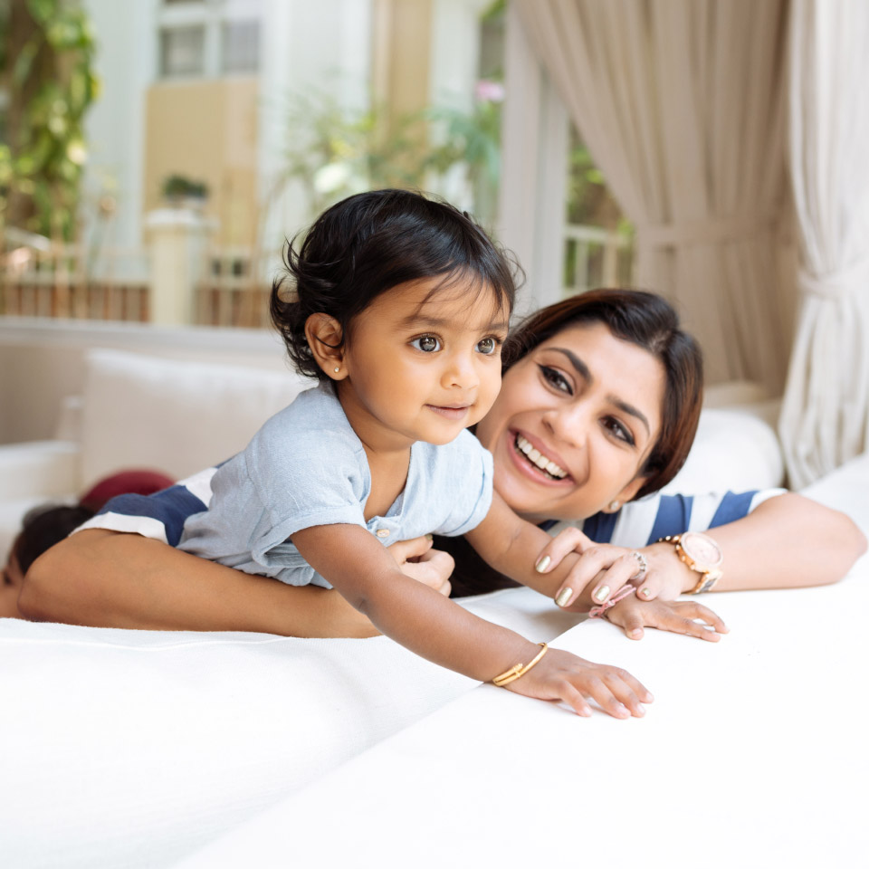 mom and baby on couch